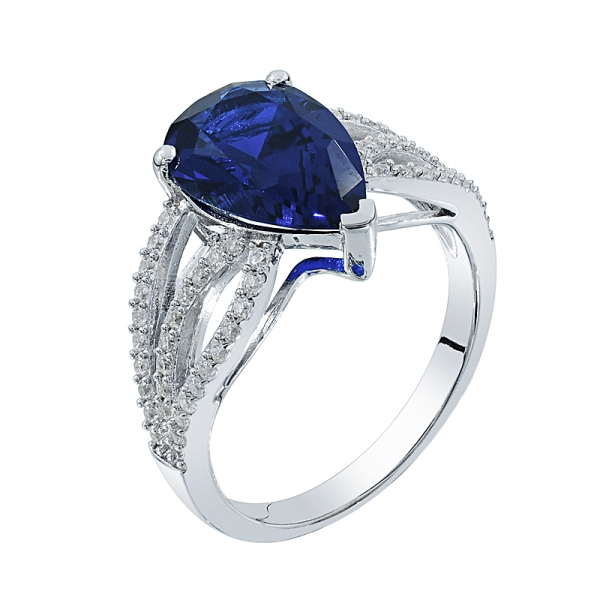 Classic Rhodium Plated Ladies Ring With Pear Shape Blue Nano